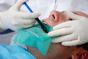 """Dentist working on a patient mouth.Many more at Dental Lightbox, cliking on any photo:More:"""